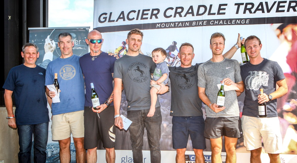 The men's team podium after Stage 3 of the 2017 Glacier Cradle Traverse, on Sunday the 7th of May. From left to right: Johan Stumpf (Managing Director Mpact), Grant Robertson & Tim Lansom (Cousins | 3rd), Andrew Stockwell & Dan Fowler (Continental Tyres | 1st) and Johan Cronje & Janus Marais (Zebra Sports | 2nd). Photo by Oakpics.com.