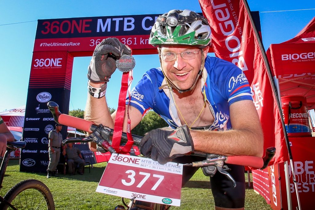Carl Scholtz poses with his 36ONE finisher's medal after completing the 2017 race. Photo by Oakpics.com.
