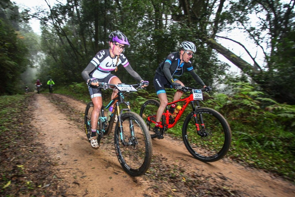 The large amount of jeep track allows for riders to ride two abreast rather than behind each other with helps facilitate conversations during the stages, even for race snakes like Sarah Hill and Gavin Salt. Photo Oakpics.com.