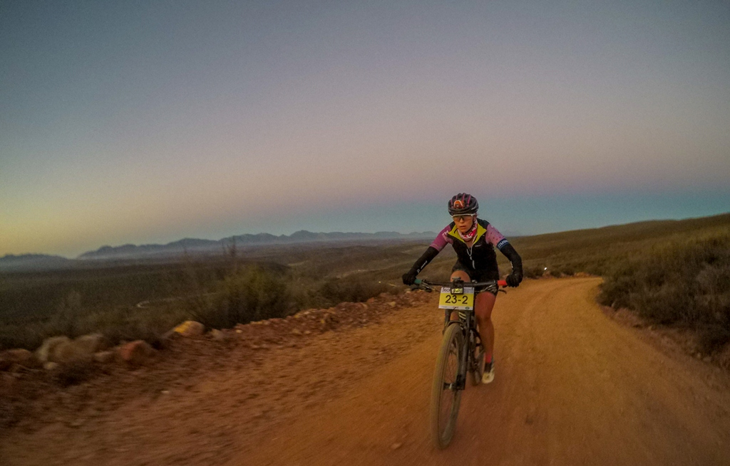 Mikayla riding into the sunset during the 2017 36ONE MTB Challenge. Photo by Kevin Benkenstein.